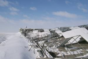 A greenhouse collapse in Illinois under the weight of winter snow.